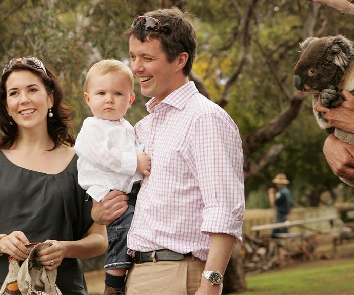 The happy parents with their firstborn and heir to the throne behind his dad, Prince Christian.