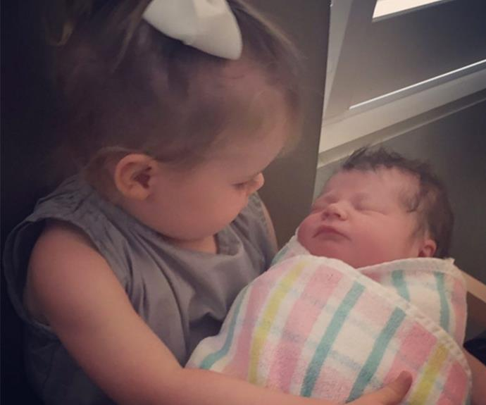 Sibling love! Tom shared this touching photo of big sister Storm cuddling her little sister Sloane.