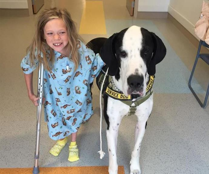 Team work! Within one short year of getting the trained service dog, Bella can now walk all by herself.
