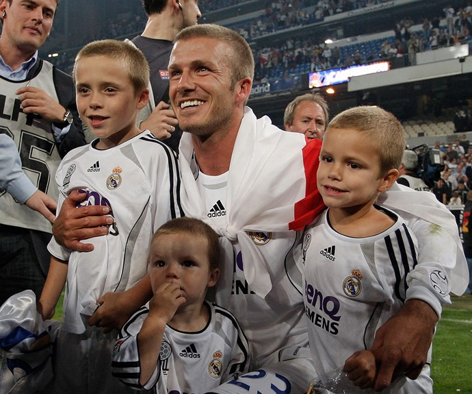 Coming full circle... The soccer pro poses with his three sons in 2007 in in Madrid, Spain. Fast forward eight years and now Brooklyn (far left) is old enough to join his dad!