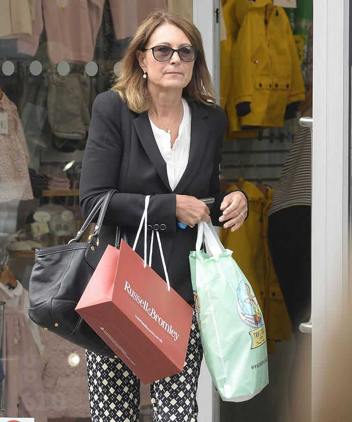 Getting the Christmas shopping done early? Doting grandma Carole Middleton was seen picking up some gifts for Prince George and Princess Charlotte  last month.