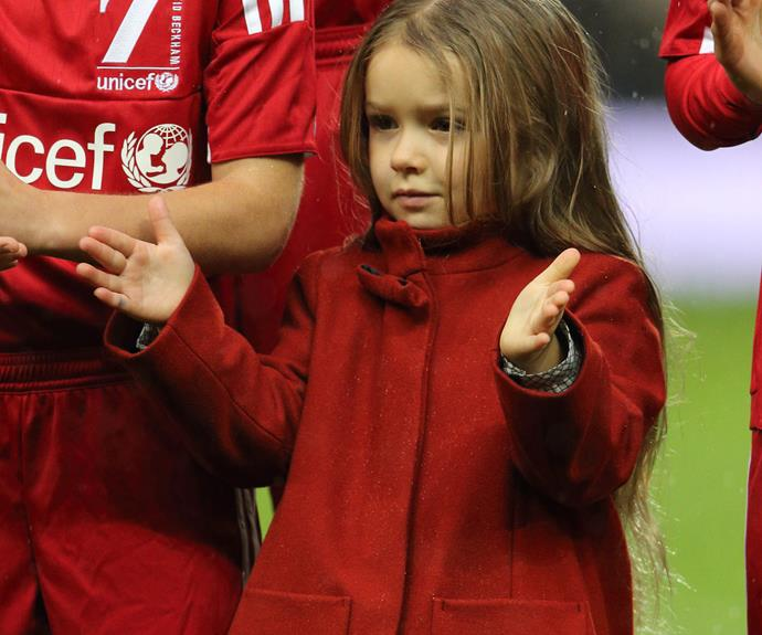 The four-year-old's golden locks tumbled over her shoulders while she rocked a bright red overcoat.