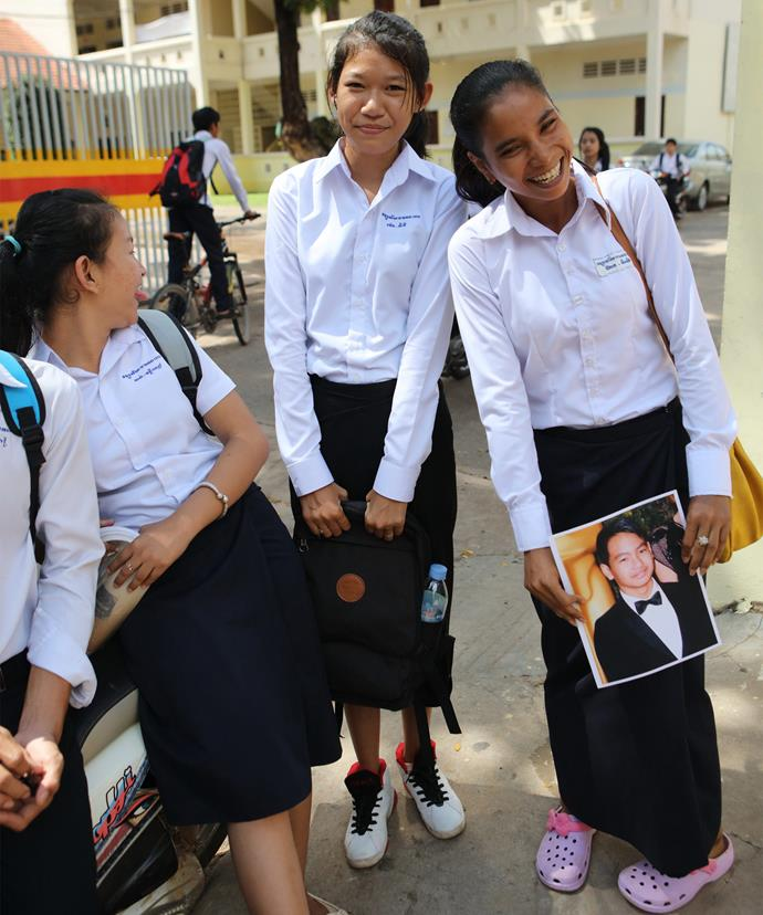 Adorable! Three Cambodian students get giggly when they see a picture of Maddox. *Photo: Coleman-Rayner*