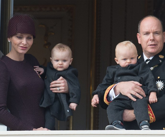 The 11-month-old siblings stole the show as they were held by their proud parents on the balcony of the royal palace.