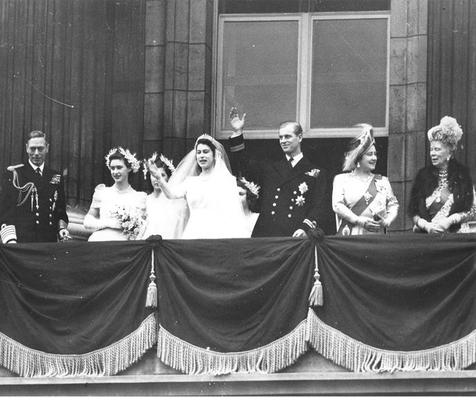 The royals pose on Buckingham Palace balcony following King George's eldest daughter's wedding on November 20, 1947.