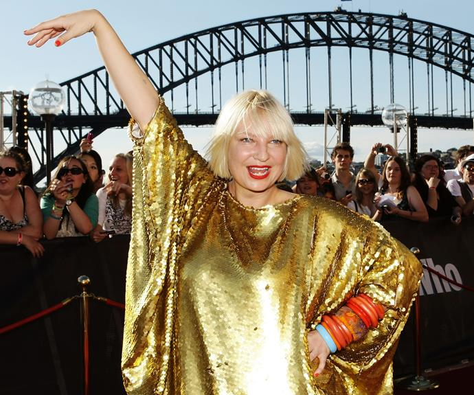 """These days, we have no idea what Sia looks like! But in 2010, it was a completely different story. The songstress couldn't have been more stoked to win two awards, including Best Pop Release. The same couldn't be said for her knockout four award win in 2014, where it's believed Sia boycotted the ceremony for being too cool. In response to the speculation, Sia took it in good humour and joked she'd give away her statues to the """"first four people to document doing a good deed."""" Putting their hand up was none other than Ed Sheeran."""