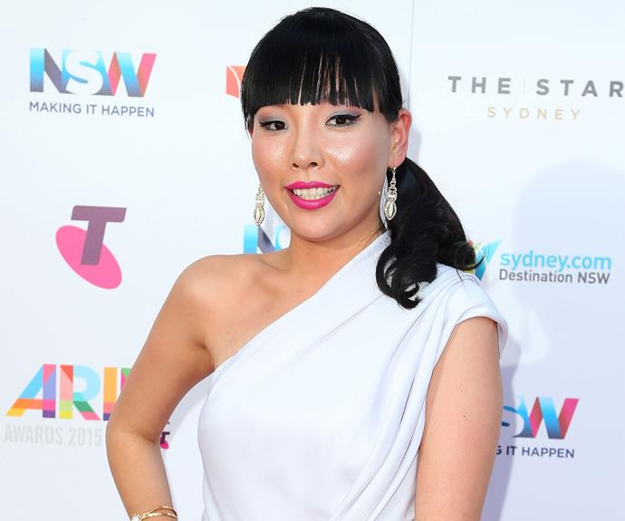 Dami Im certainly brings her X Factor in this chic white dress and sleek ponytail.