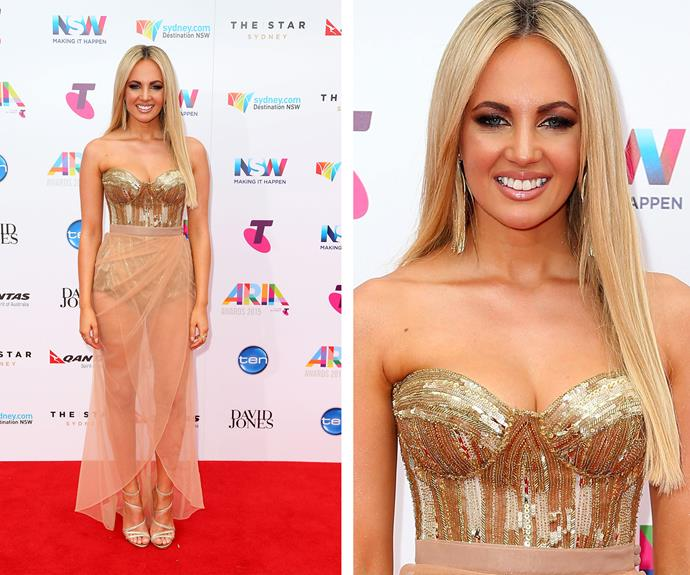Samantha Jade positively sparkled in a strapless gold bodice which she teamed with a blush pink skirt.