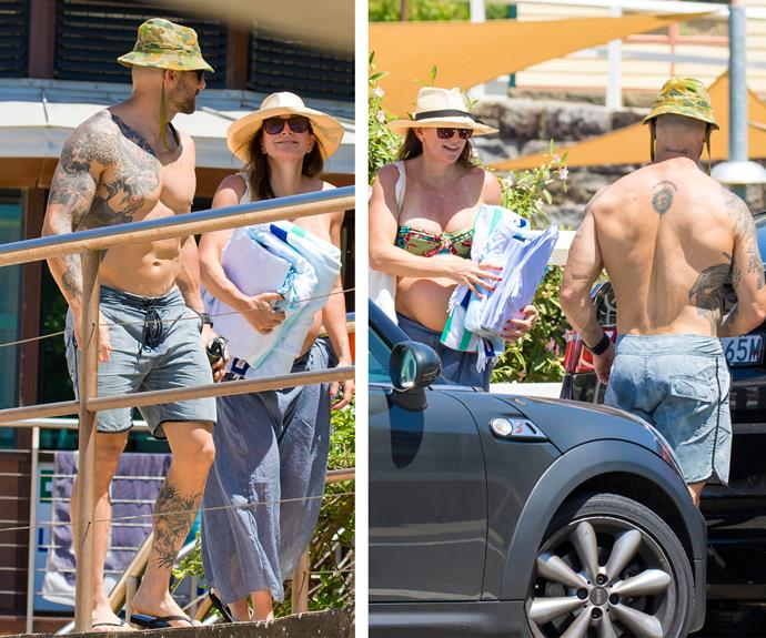 The couple were all smiles as they made their way home after their day in the sun at Sydney's Tamarama Beach.