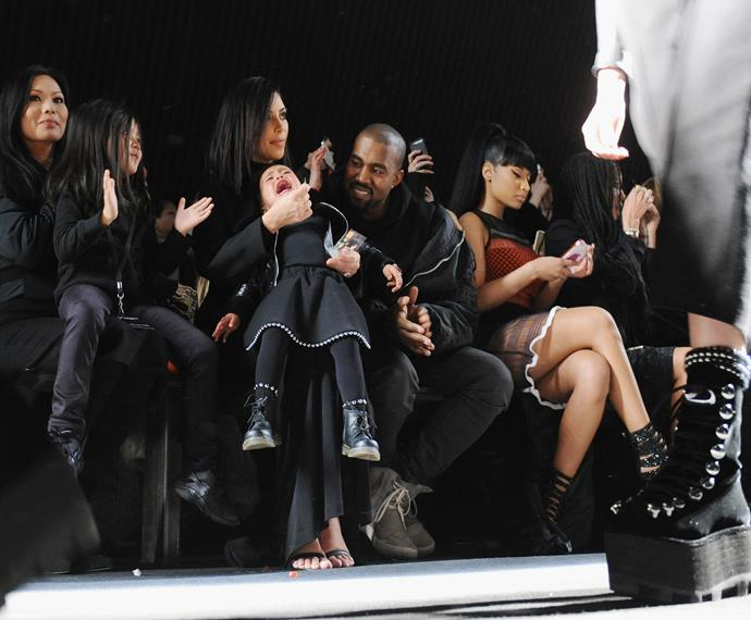 North West can teach him how to be the focus of attention, even at high-fashion events. Miss West is still not sorry about her infamous front-row tanty at Alexander Wang at New York Fashion Week earlier this year.