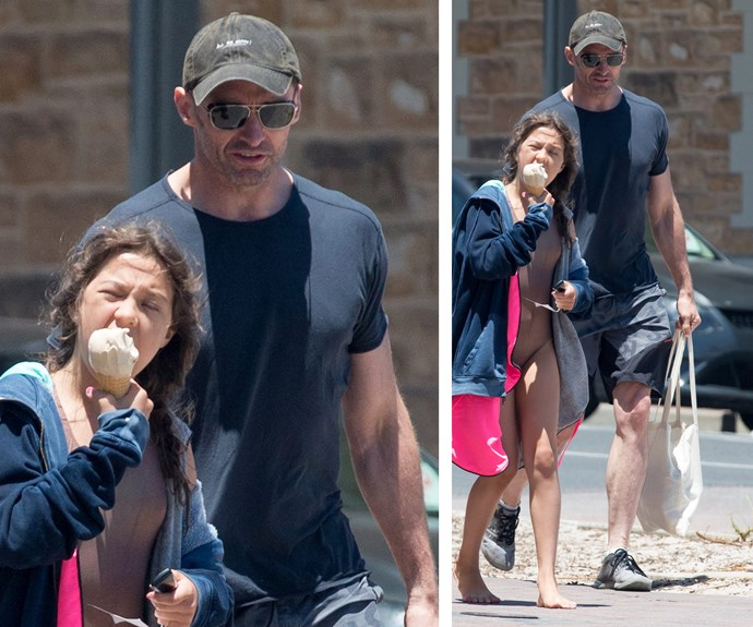 The sweet dad treated his daughter to a scoop of ice cream.