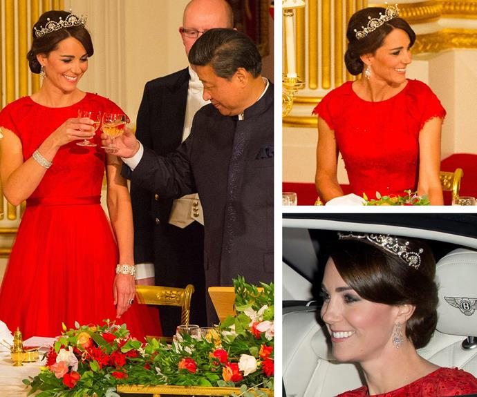 "**Lady in red:** The Duchess was a vision in this Jenny Packham gown and the [Royal's Lotus Flower tiara](https://www.nowtolove.com.au/royals/british-royal-family/duchess-catherine-best-tiara-moments-43452|target=""_blank"") when she attended her first state banquet to honour the Chinese President Mr Xi Jinping in October, 2015."