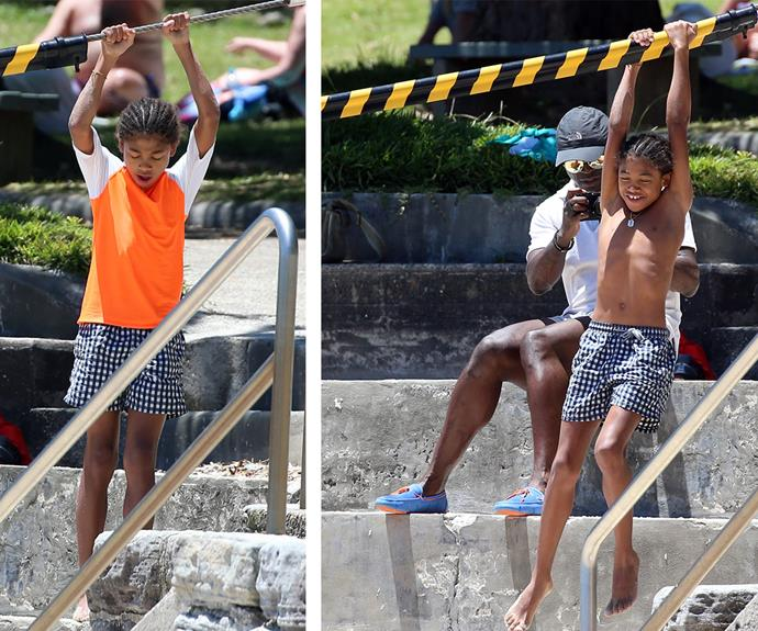 Say cheese! Seal snapped photos of his son as he swung about.