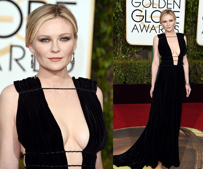 Kirsten Dunst opted for a daring black gown with a plunging neck-line.