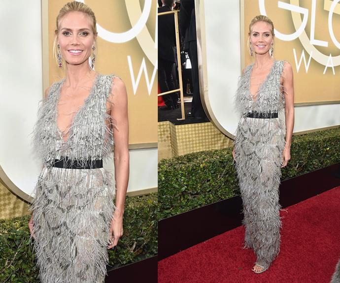 Heidi Klum worked a textured feathered number while her blonde locks were swept back into a chic up do.