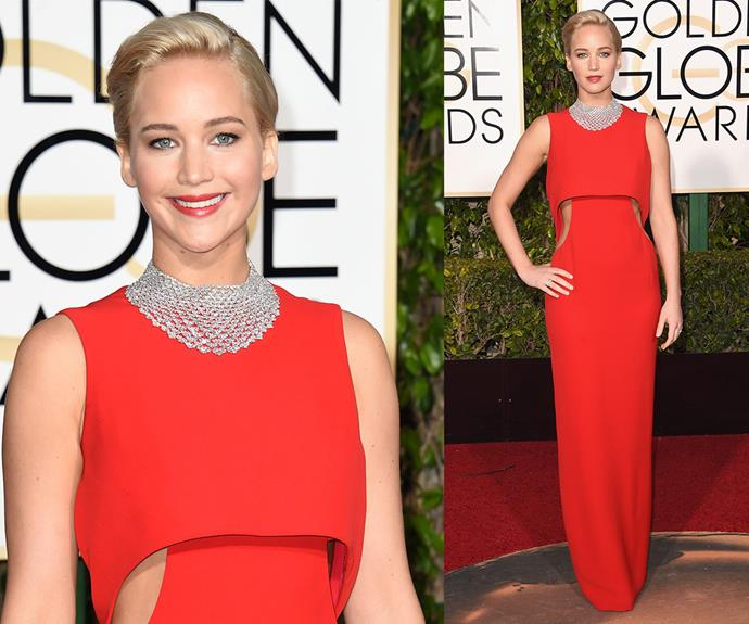 A pure Joy! Best Actress winner Jennifer Lawrence dazzled in an elegant red floor-length dress which she accessorised with a netted silver statement necklace, slicked back tresses and a bright red lip.