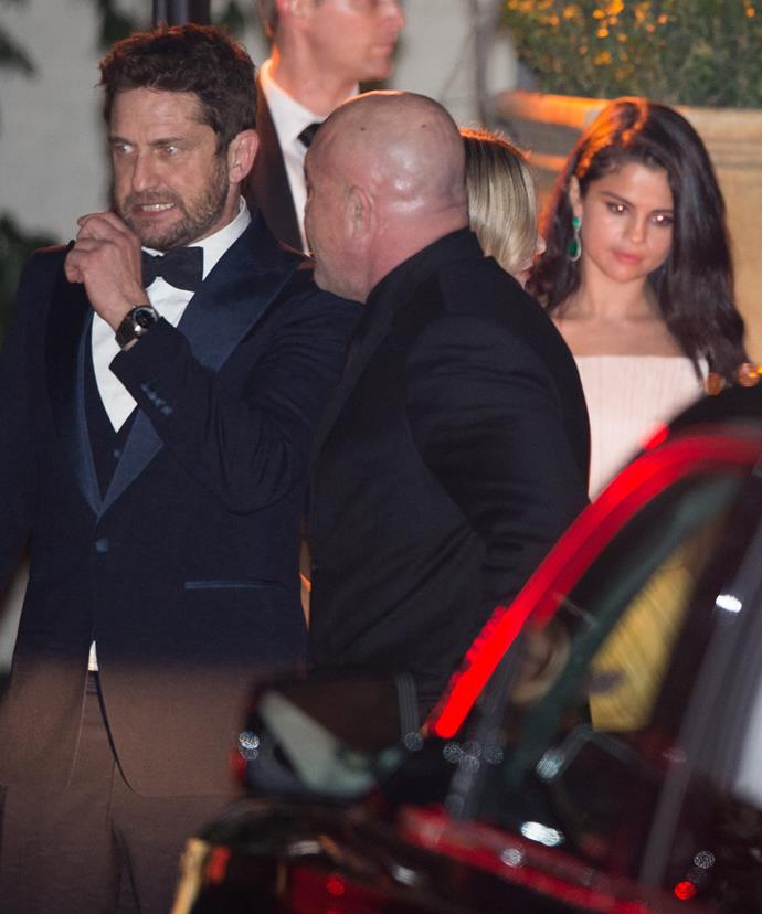 Busted? Gerard makes a stealth exit from CAA's Golden Globes party with Selena not far behind.