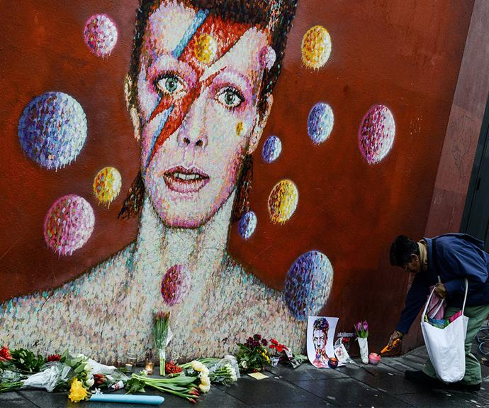 The famous Bowie mural in Brixton has become a shrine.