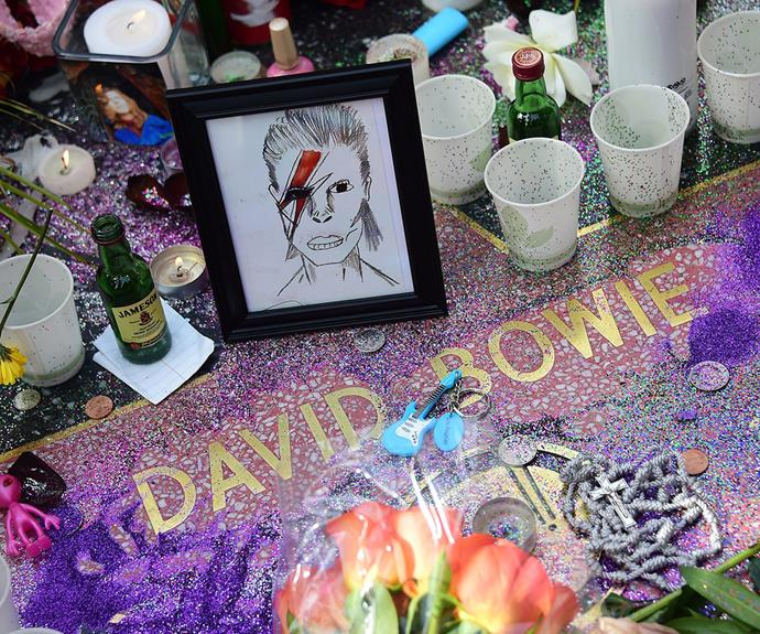 The singer's star on the Hollywood Walk of Fame has been covered in glitter, flowers and champagne.