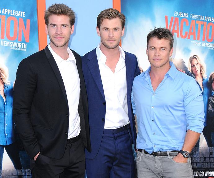 A Hemsworth sandwich: *The Last Song* actor cuddles up to big brothers Chris and Luke at the *Vacation* premiere in LA last year. We really don't know where to look...