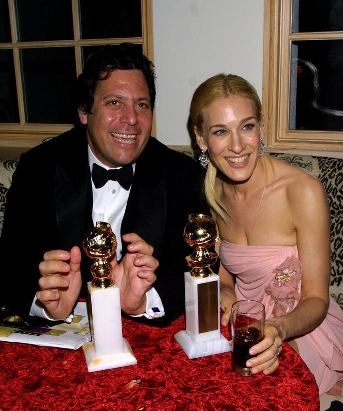 Darren Starr and Sarah Jessica Parker at the 58th Annual Golden Globe Awards HBO after party with their awards for Best Comedy and Best Actress respectively.