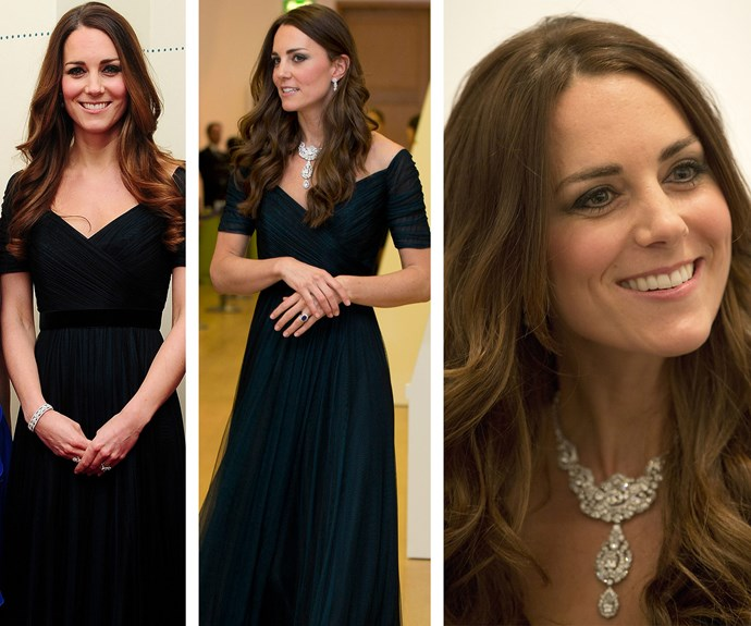 Just one day after Prince George's christening (L) in October 2013, Catherine donned this exquisite Jenny Packham navy gown.  Months later in February 2014 (R) wore the full-length dress with a wrap-style bodice again to the National Portrait Gallery Gala with the addition of the [Queen's diamond necklace](http://www.womansday.com.au/royals/royal-style/the-british-royal-familys-jewellery-collection-14057).