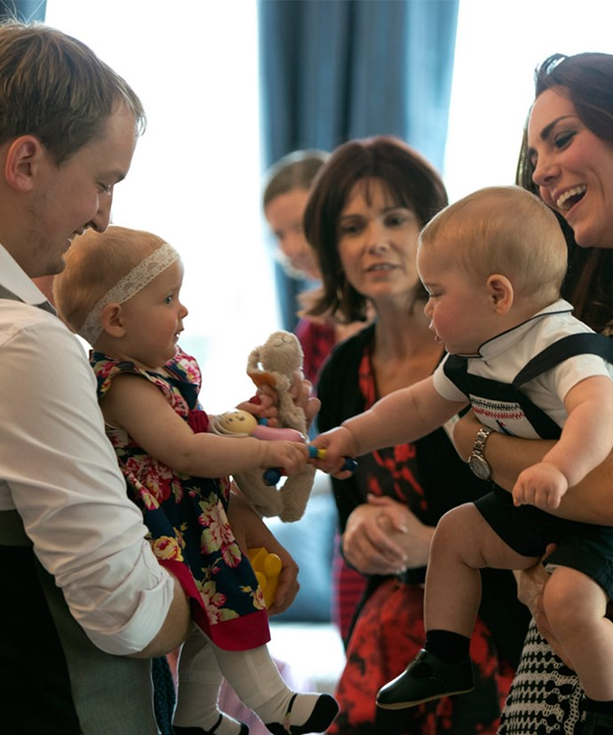 Prince George, seen here with mum Catherine in New Zealand, loves playing with other kids.