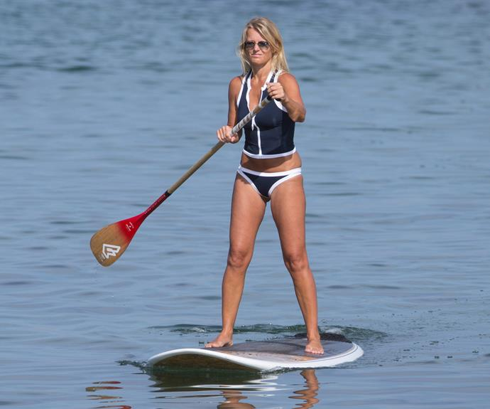 Simone Callahan shows off her killer body as she hits the water this summer. Shane Warne's ex-wife put on an impressive display as she paddleboarded at Brighton beach wearing a navy tankini top and matching bottoms.