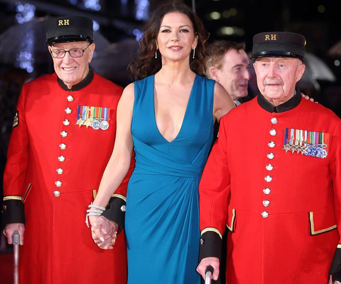 Catherine managed to rustle up two very charming dates. Arm-in-arm, everyone was smiles as the Brunette beauty walked the red carpet with war veterans, the Chelsea Pensioners.