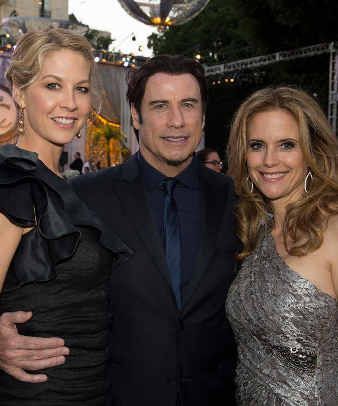 John with fellow celebrity Scientologist Jenna Elfman (left) and his wife Kelly Preston at a Scientology event.
