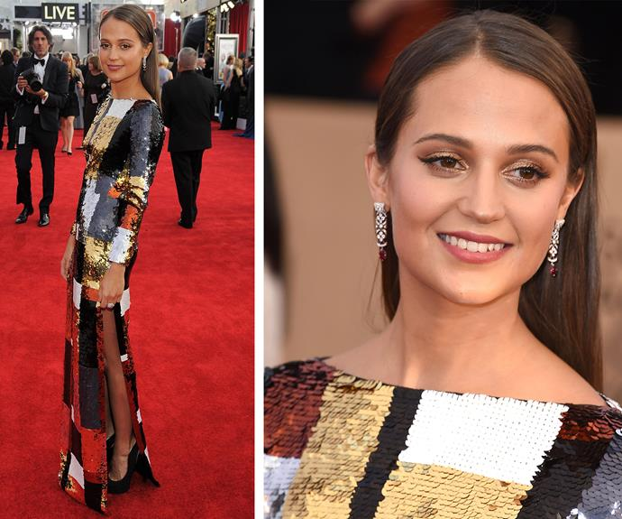 Alicia Vikander dares to sparkle in this glittery number.