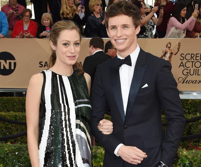 Eddie Redmayne is all smiles as he poses with his pregnant wife, Hannah Bagshawe.
