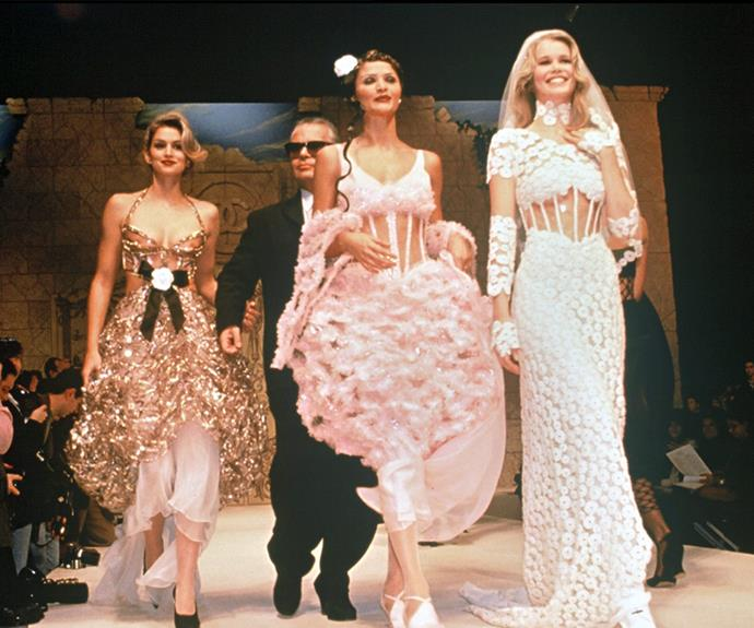 Fashion's It Girls continued to slay at the 1993 Chanel show in Paris. (L-R) Cindy Crawford, Karl Lagerfeld, Helena Christensen and Claudia Schiffer stunned on the runway.