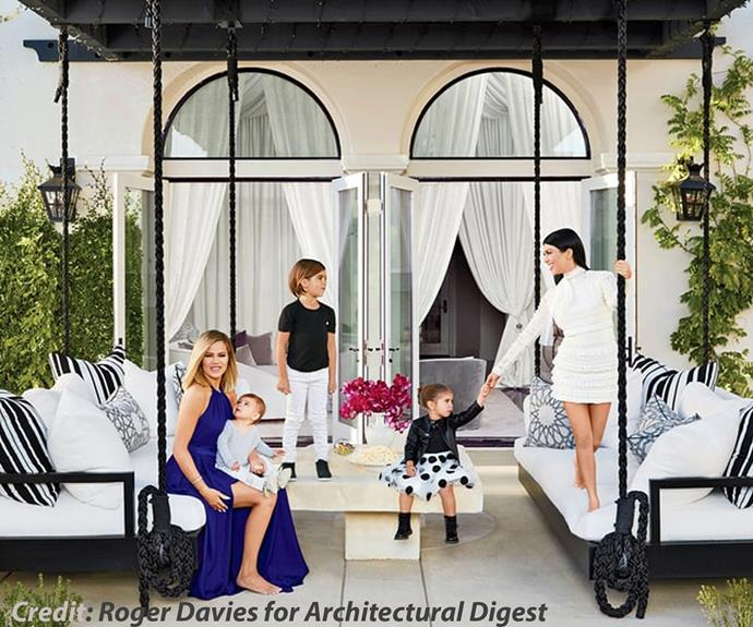 Talk about keeping up with the fabulous! Khloe and Kourtney Kardashian opened up the doors to their breathtaking homes for the annual *Celebrities at Home* issue of [*Architectural Digest's*](http://www.architecturaldigest.com/story/kourtney-khloe-kardashian-house-tour). The sisters graced the coveted cover and were joined by Kourt's three kids, Penelope, three, Mason, six, and Reign, 13 months.