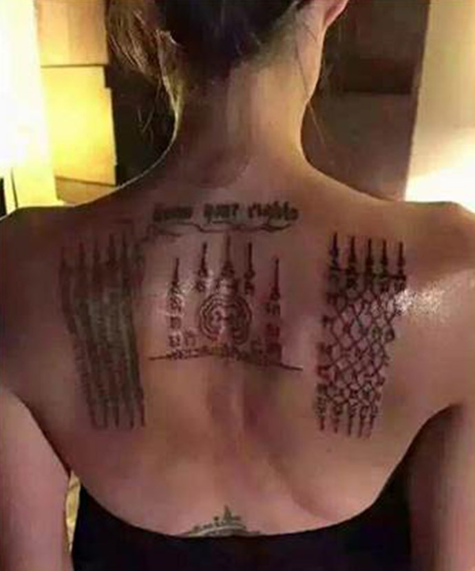 *Woman's Day* found the image of Angelina's new ink, on the centre and right of her shoulders, on social media.