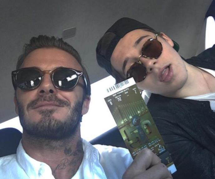 """SUPER BOWL BABY ..... My boys first one so you can see by his face he is excited,"" proud dad David Beckham penned alongside this snap with Brooklyn."