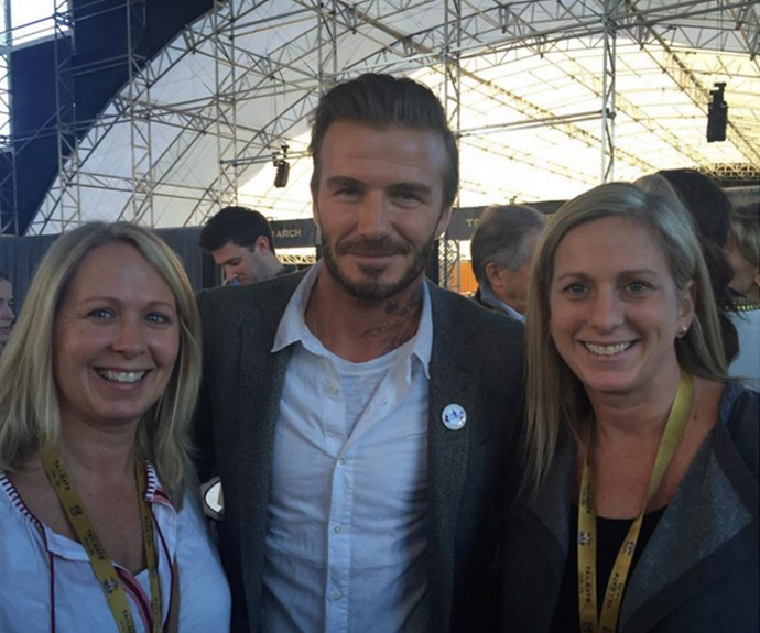 David Beckham was also at the Super Bowl - here, he's pictured posing with two lucky fans.