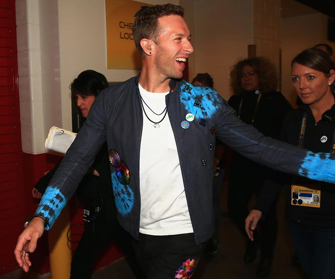 Here he comes! Chris Martin lingers backstage ahead of the half-time show.