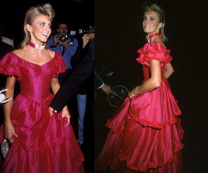 You're the one that we want! Olivia Newton-John looked like a real-life Barbie doll in this jaw-dropping fuchsia frilly gown at the 1983 bash.