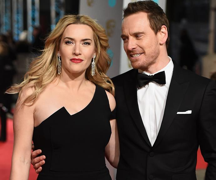 The apple of his eye: Michael Fassbender can't stop looking at his *Jobs* co-star Kate Winslet.