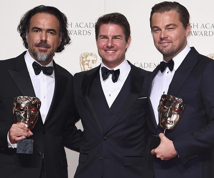 Tom Cruise poses with *The Revenant* director Alejandro González Iñárritu and his leading man, Leonardo DiCaprio.