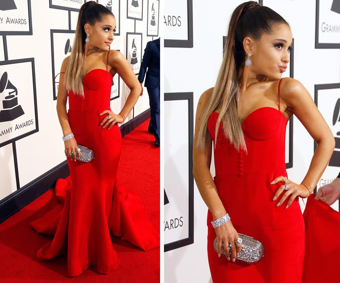 Ariana Grande flaunted her petite figure in a bustier red dress.
