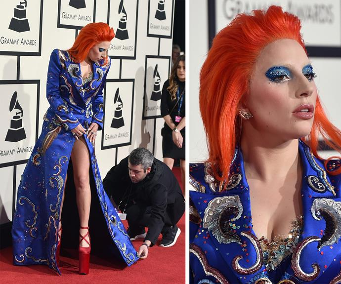 With a bright orange wig and a glittering cape ensemble, Gaga looked out of this world!