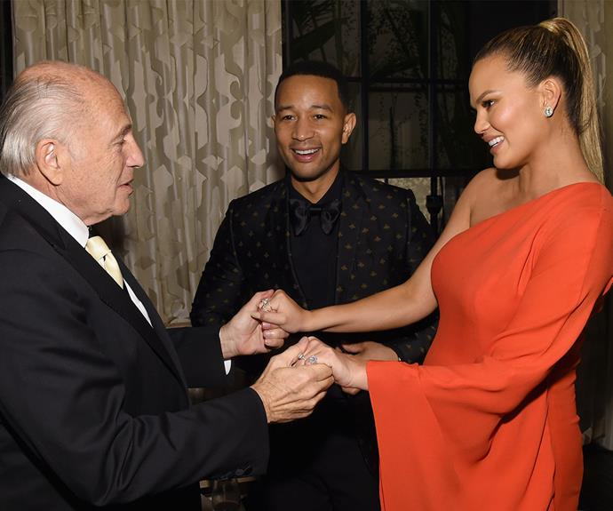 Chairman and CEO of Sony Music Entertainment, Doug Morris, looked pretty happy to see the beautiful mum-to-be, Chrissy Teigen and her musician Husband, John Legend.