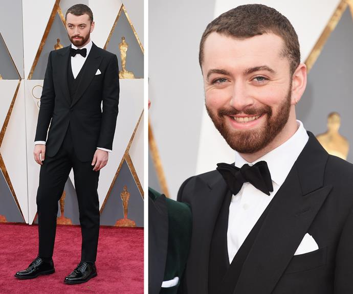 Sam Smith, who is up for Best Original Song with Jimmy Napes for their music and lyrics on *Writing's On The Wall* from *Spectre*, opted for a dapper tux.