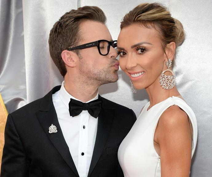 *E!* co-stars Brad Goreski and Giuliana Rancic pucker up.