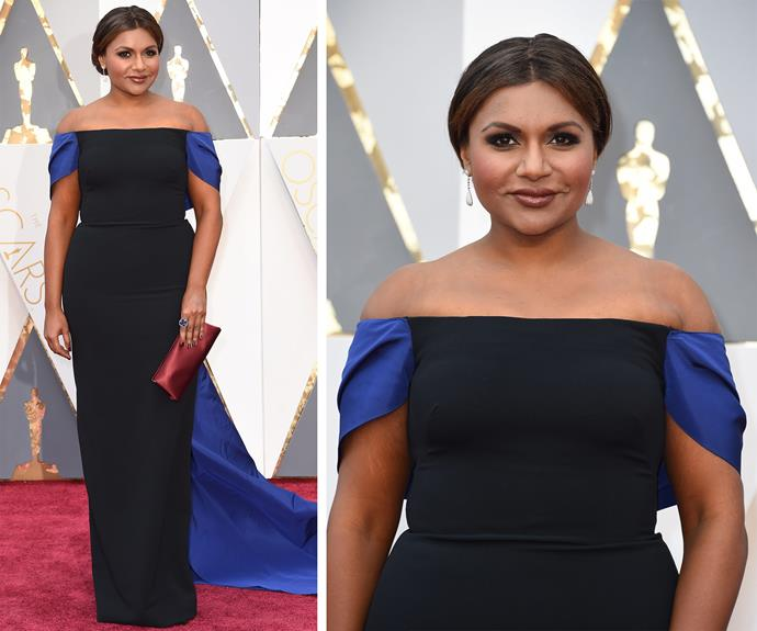 Mindy Kaling looked stunning in a chic off-the-shoulder black gown with a deep blue shoulder detail.