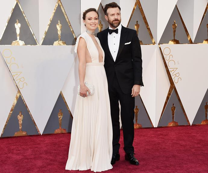Cute couple Olivia Wilde and Jason Sudeikis cuddled up on the red carpet. The actress commanded attention in a dramatic Valentino frock.