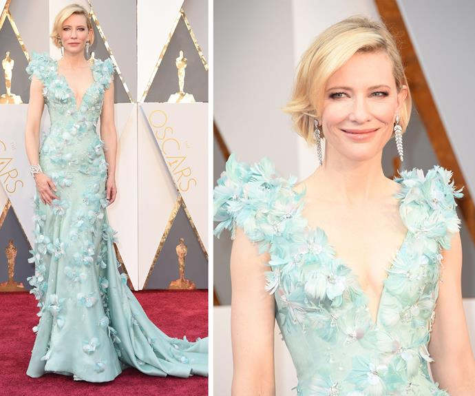 Bow down! Best Actress nominee Cate Blanchett has arrived and she looks stunning in this show-stopping textured sea-foam green gown by Armani.