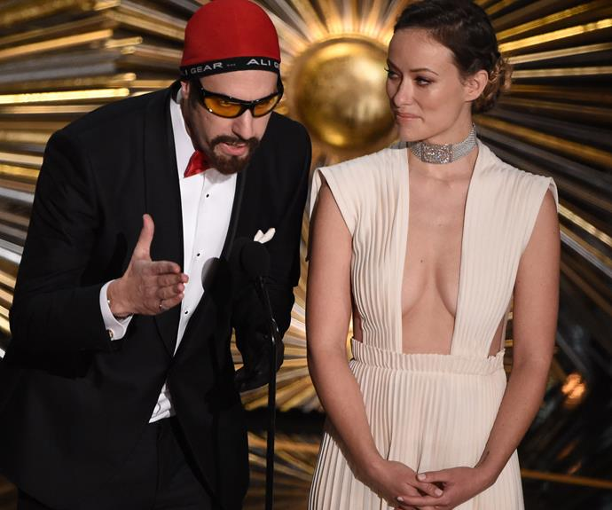 Sacha Baron Cohen was in character as he presented alongside Olivia Wilde.
